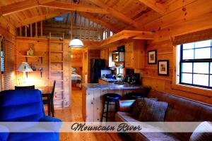 Mtn River Log Cabin - Living Room and Kitchen